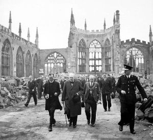 Winston Churchill visits Coventry Cathedral in ruins after the bombing of 14/15 November 1940
