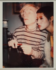 Andy Warhol. Andy Warhol and Unidentified Woman, 1970. Polacolor Type 108. 4 1/2 x 3 3/8 in. Gift of The Andy Warhol Foundation for the Visual Arts, Inc., 2014.002.18. © 2015 The Andy Warhol Foundation for the Visual Arts, Inc. / Artists Rights Society (ARS), New York. Photo: Richard Nicol